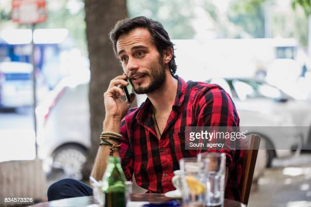 Hipster in plaid shirt at the cafe