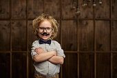 Little hipster with glasses in studio