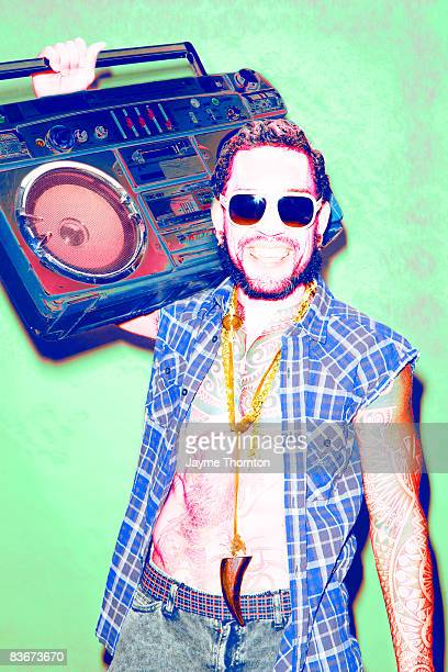 Hipster man holding boombox