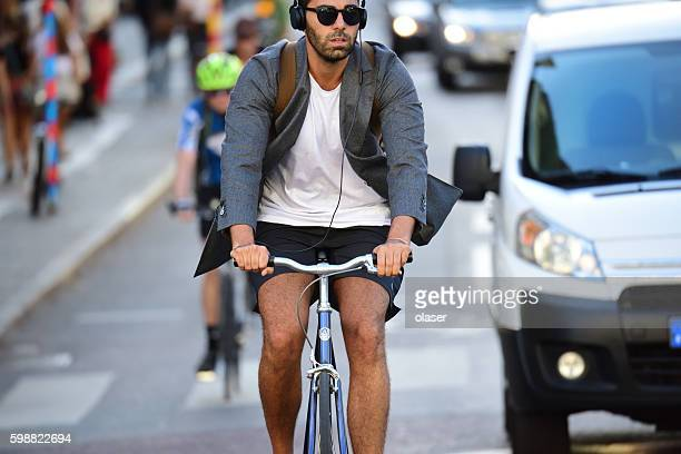 Hipster man in suit jacket and shorts.