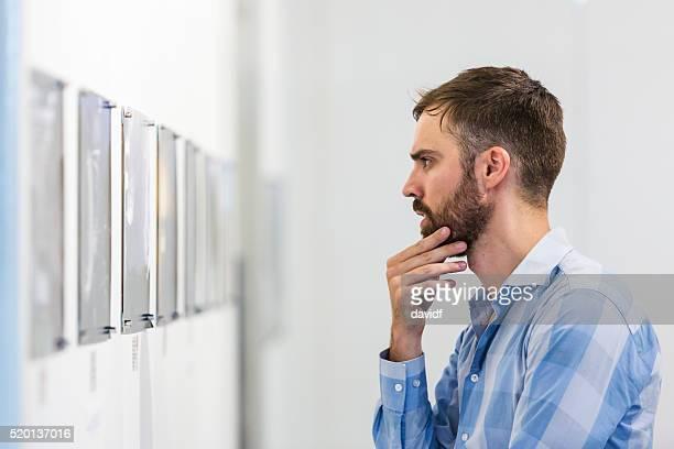 Hipster Man Visiting an Art Gallery