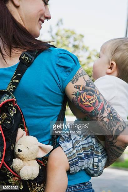Hipster mother holding toddler