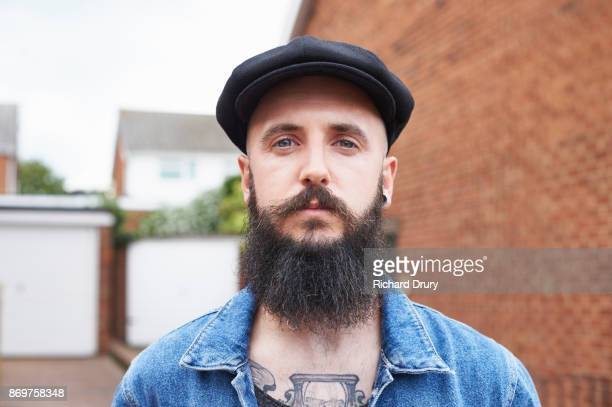 Hipster outside his house