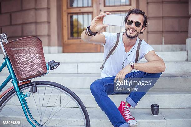 Hipster sitting on the steps