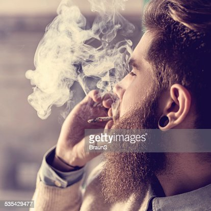 Hipster smoking pot.