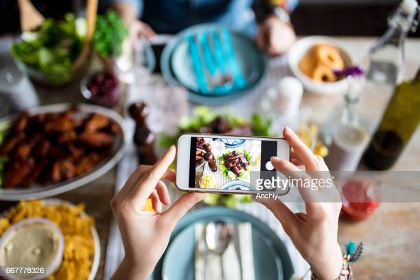 Hipster taking photo for social media before eating it