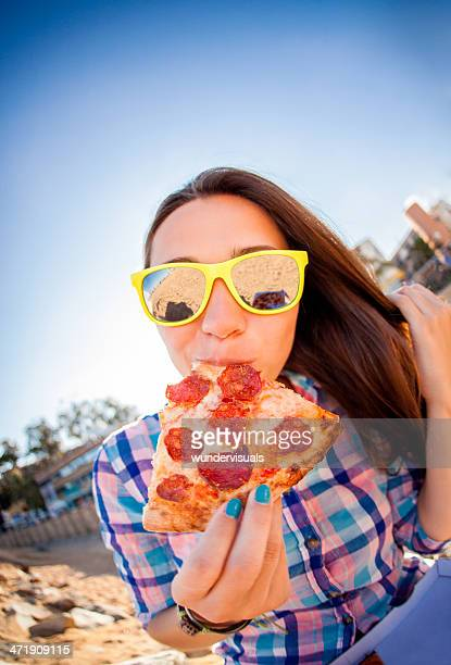 Hipster Wearing Sunglasses Eating Pizza