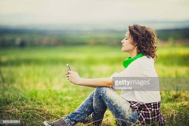 Hipster woman using her smart phone