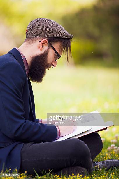 Hipster writing and reading