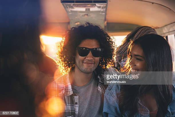 Hipster young couple making a summer road trip with friends