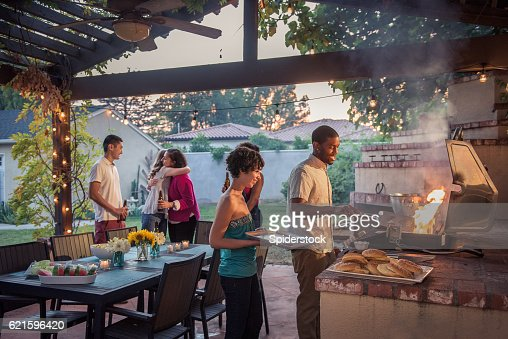 Hipster Backyard Bbq : Hipsters Grilling at a Summer Backyard BBQ
