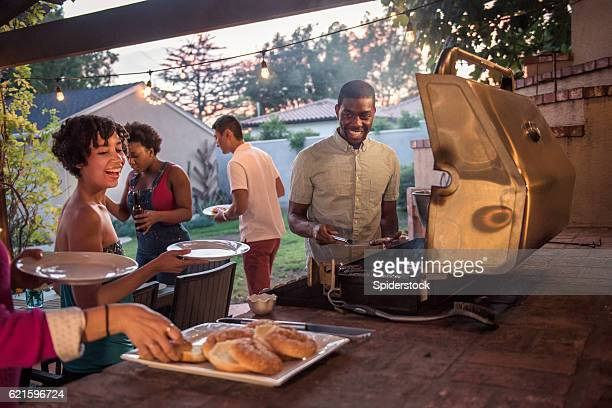 Hipsters Grilling at a Summer Backyard BBQ