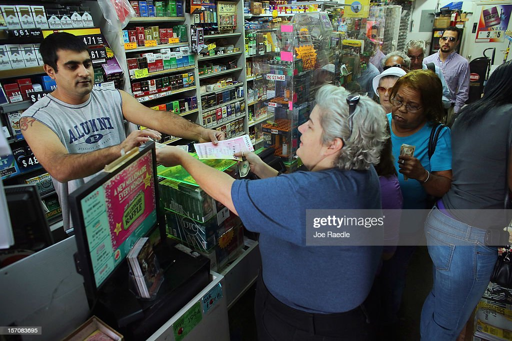 Hiral Patel sells Powerball tickets at Circle News Stand on November 28, 2012 in Hollywood, Florida. The jackpot for Wednesday's Powerball drawing is currently at $550 million which is the richest Powerball pot ever. It is likely to rise even more as people continue to buy before tonights drawing.