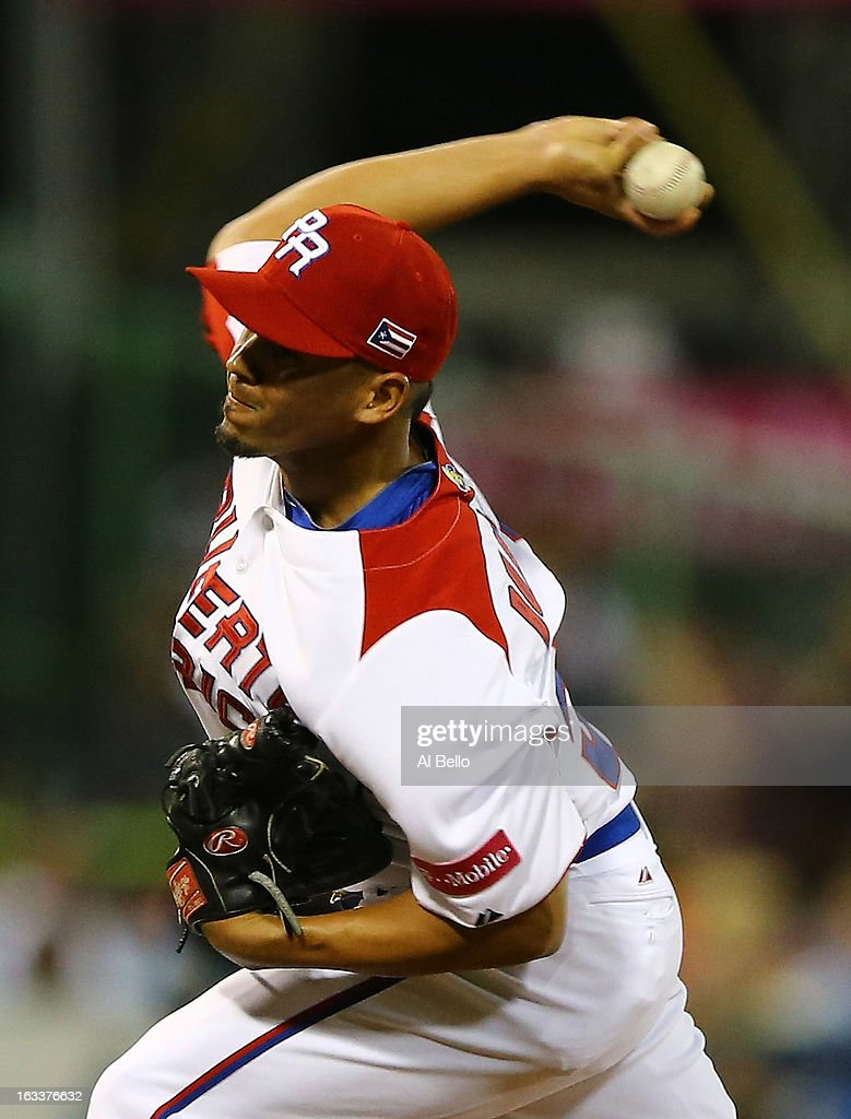 Hiram Burgos #54 of Puerto Rico pitches against Spain during the first round of the World Baseball Classic at Hiram Bithorn Stadium on March 8, 2013 in San Juan, Puerto Rico.