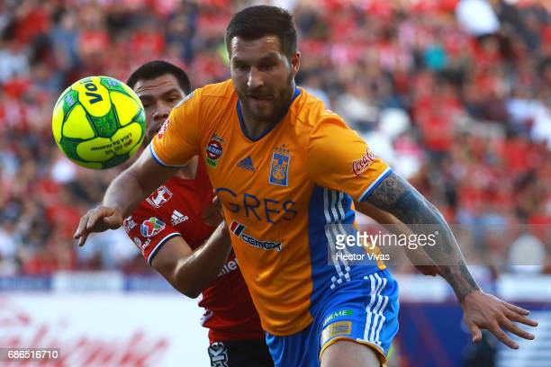 Hiram Muñoz of Tijuana struggles for the ball with Andre Pierre Gignac of Tigres during the semi final second leg match between Tijuana and Tigres...