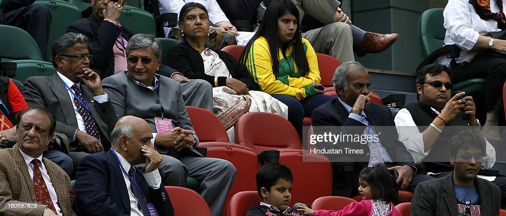Hiranmoy Chatterjee (2L), Bharat Oza (4L), and Karti Chidambaram (2R) at the VIP stand during Davis Cup reverse single match between VM Ranjeeth of India and Jeong Suk Young of Korea at Delhi Lawn Tennis Association stadium on February 3, 2013 in New Delhi, India.