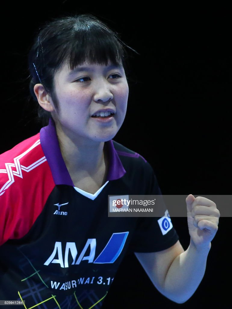 Hirano Miu of Japan reacts after winning a point against Tianwei Feng of Singapore during their women's singles quarter final table tennis match in the ITTF Nakheel Table Tennis Asian Cup, on April 29, 2016 in Dubai. / AFP / MARWAN