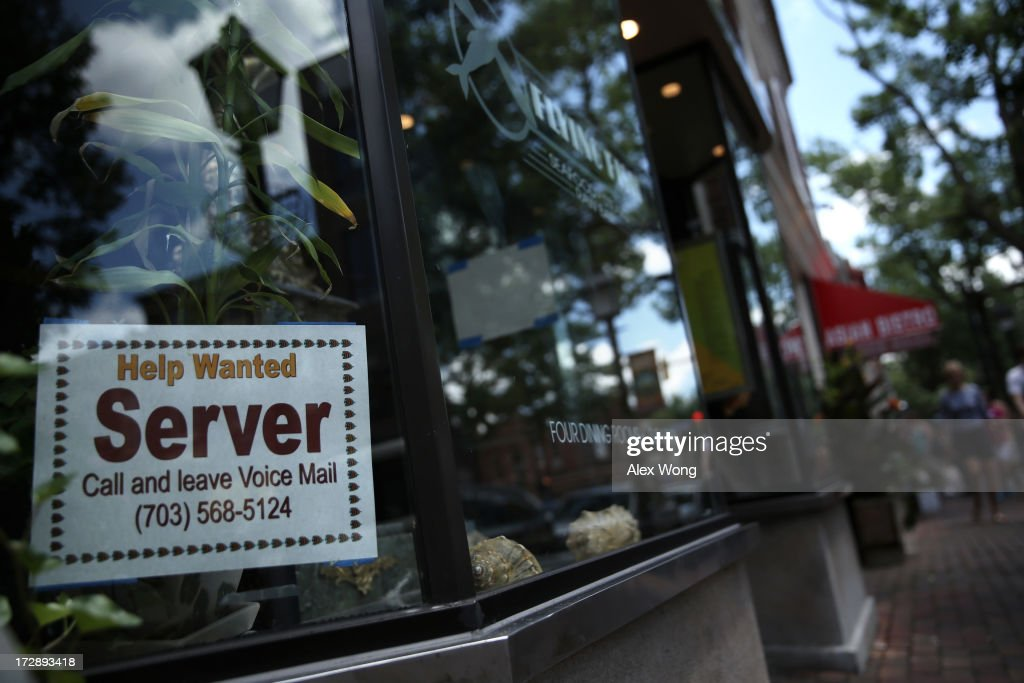 A hiring sign is seen at a restaurant July 5, 2013 in Old Town Alexandria, Virginia. The Labor Department reported that U.S. economy has added 195,000 jobs in June with the unemployment rate remained unchanged at 7.6 percent.