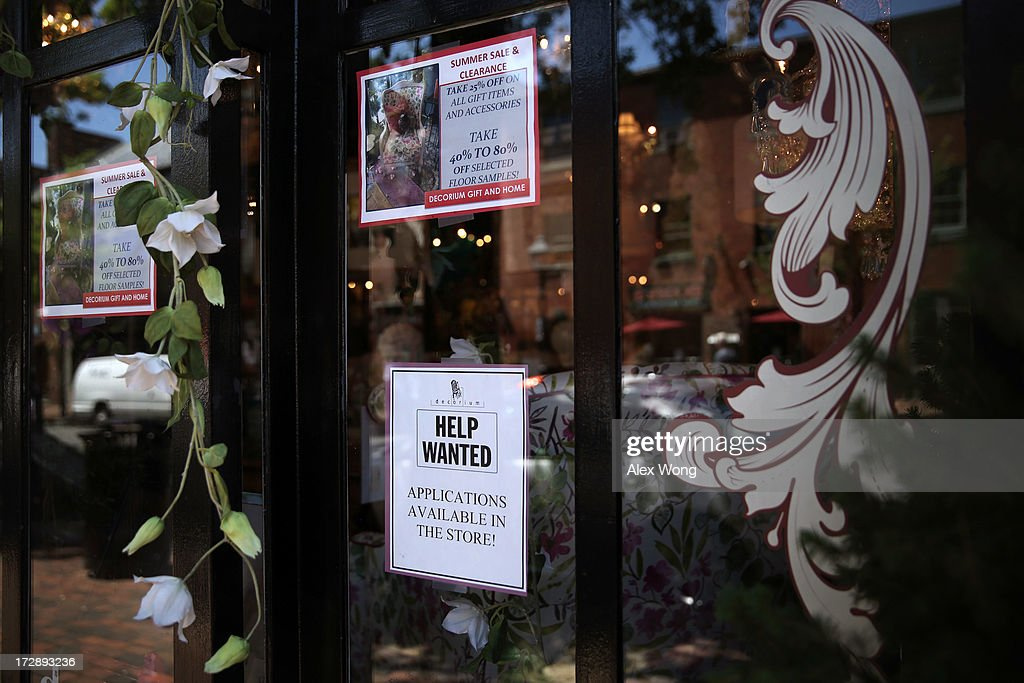 A hiring sign is seen at a shop July 5, 2013 in Old Town Alexandria, Virginia. The Labor Department reported that U.S. economy has added 195,000 jobs in June with the unemployment rate remained unchanged at 7.6 percent.