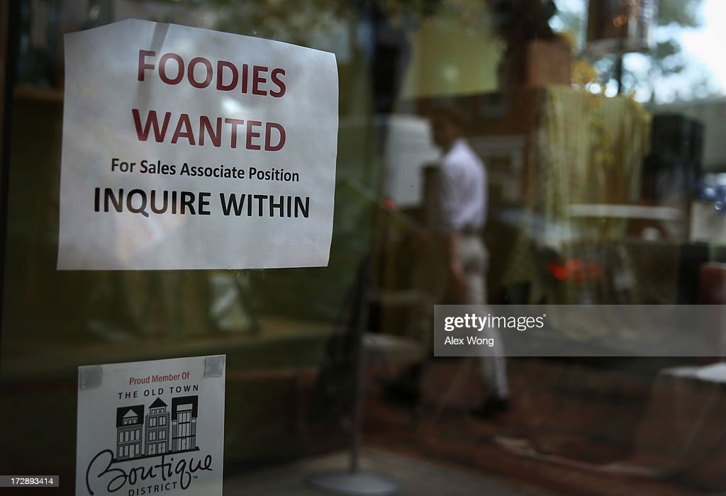 A hiring sign is seen July 5, 2013 in Old Town Alexandria, Virginia. The Labor Department reported that U.S. economy has added 195,000 jobs in June with the unemployment rate remained unchanged at 7.6 percent.