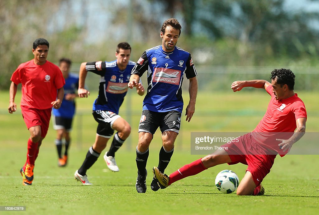 Hiro Poroiae of Tahiti competes with Paul Reid of Sydney during the friendly match between Sydney FC and Tahiti at Macquarie Uni on February 6, 2013 in Sydney, Australia.