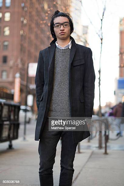 Hiro Yamamoto is seen on Michigan Avenue wearing a black Banana Republic coat Abercrombie grey sweater and black pants and Jins glasses on December...