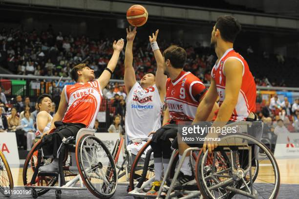 Hiroaki Kozai of Japan in action during the Wheelchair Basketball World Challenge Cup third place match between Turkey and Japan at the Tokyo...