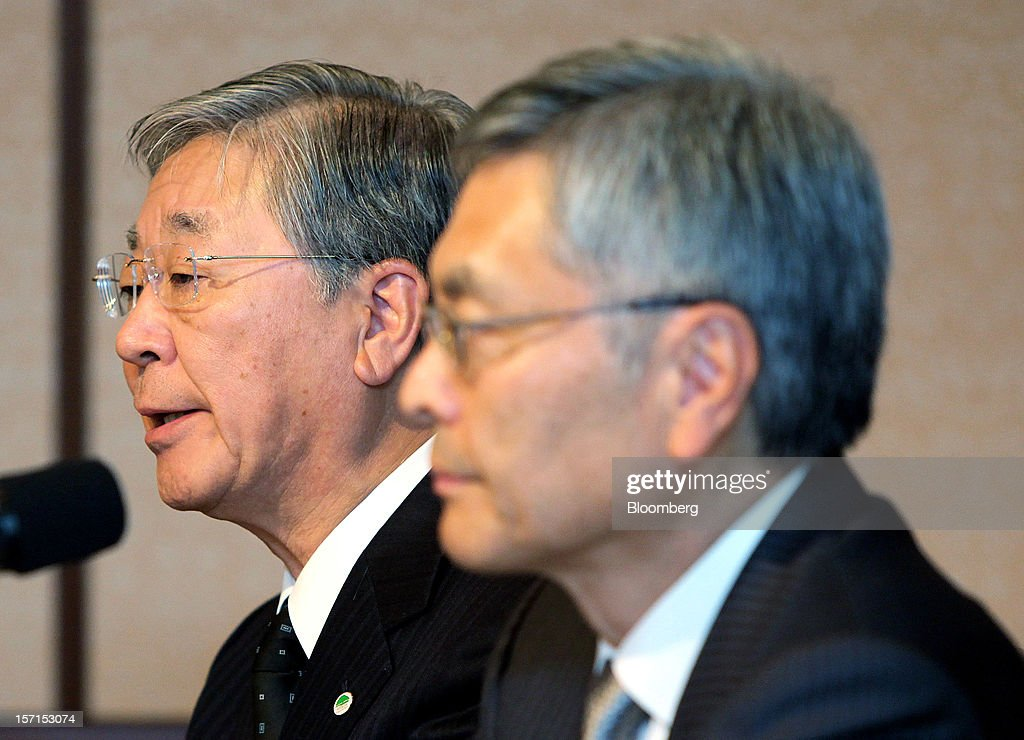 Hiroaki Nakanishi, president of Hitachi Ltd., left, speaks as Hideaki Omiya, president and chief executive officer of Mitsubishi Heavy Industries Ltd., listens during a joint news conference in Tokyo, Japan, on Thursday, Nov. 29, 2012. Mitsubishi Heavy Industries and Hitachi agreed to merge power-equipment businesses with combined sales of 1.1 trillion yen ($13 billion) to bolster their product line-ups and global sales reach. Photographer: Haruyoshi Yamaguchi/Bloomberg via Getty Images