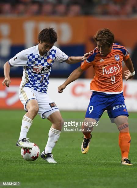 Hiroaki Okuno of Vegalta Sendai and Ryohei Yamazaki of Albirex Niigata compete for the ball during the JLeague J1 match between Albirex Niigata and...