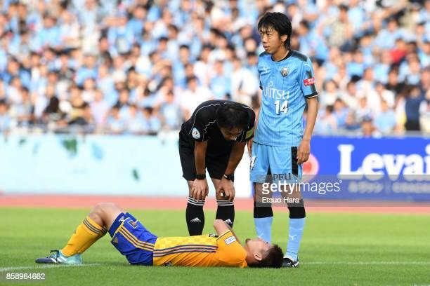 Hiroaki Okuno of Vegalta Sendai lies injured during the JLeague Levain Cup semi final second leg match between Kawasaki Frontale and Vegalta Sendai...