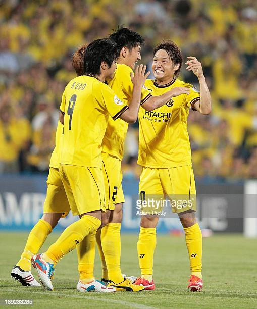 Hirofumi Watanabe of Kashiwa is congratulated after scoring a goal during the AFC Champions League round of 16 match between Kashiwa Reysol and...