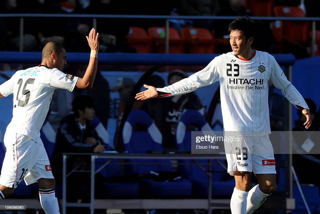 Hirofumi Watanabe (R) of Kashiwa Reysol celebrates scoring the first goal with his team mate Jorge Wagner during the 92nd Emperor's Cup Final match between Gamba Osaka and Kashiwa Reysol at the National Stadium on Janaury 1, 2013 in Tokyo, Japan.