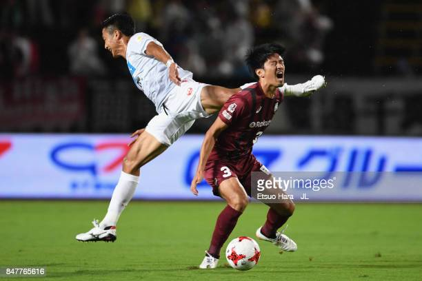 Hirofumi Watanabe of Vissel Kobe and Ken Tokura of Consadole Sapporo compete for the ball during the JLeague J1 match between Vissel Kobe and...