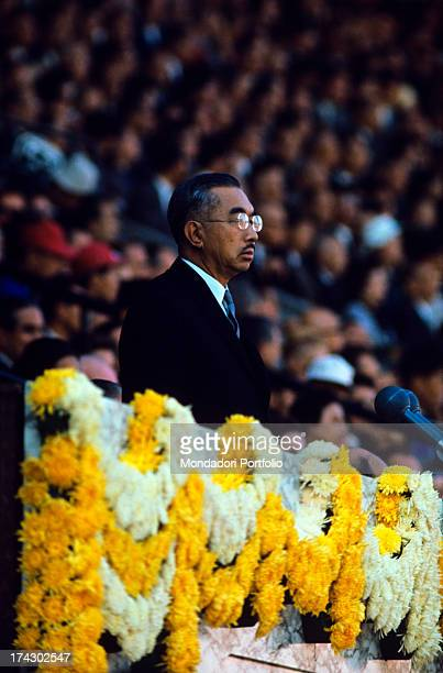 Hirohito the 124th Emperor of Japan according to the traditional order is carefully watching at the games of the XVIII Olimpiad Tokyo October 1964