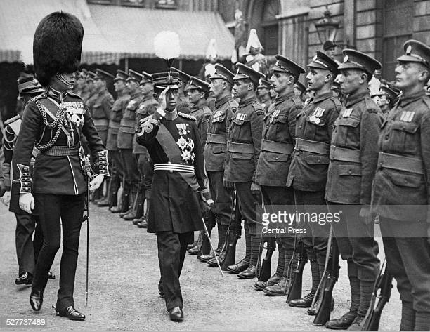Hirohito the Crown Prince of Japan inspects a Guard of Honour of World War I heroes at the Guildhall in London during his sixmonth European tour May...