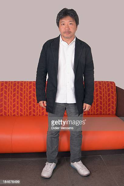 Hirokazu KoreEda director of Like Father Like Son poses for a photoshoot at the 40th Ghent Film Festival on October 14 2013 in Gent Belgium