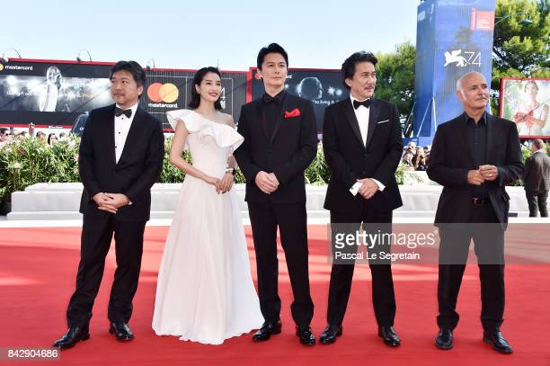 Hirokazu Koreeda Suzu Hirose Koji Yakusho Masaharu Fukuyama and Ludovico Einaudi walk the red carpet ahead of the 'The Third Murder ' screening...