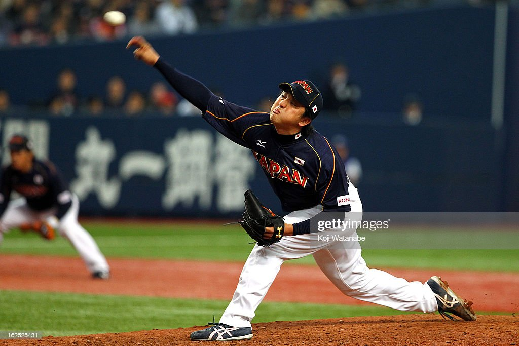 Hirokazu Sawamura #15 of Japan pitches against Australia in the top half of the fourth inning during the international friendly game between Australia and Japan at Kyocera Dome Osaka on February 24, 2013 in Osaka, Japan.