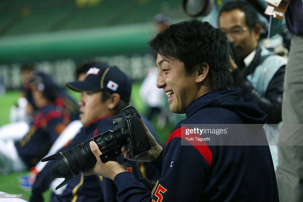 <a gi-track='captionPersonalityLinkClicked' href=/galleries/search?phrase=Hirokazu+Sawamura&family=editorial&specificpeople=7074250 ng-click='$event.stopPropagation()'>Hirokazu Sawamura</a> #4 of Team Japan takes photos during the World Baseball Classic workout day at the Yahoo Dome on February 27, 2013 in Fukuoka, Japan.