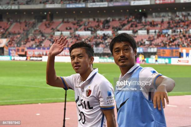 Hiroki Abe and Mitsuo Ogasawara of Kashima Antlers applaud supporters after their 42 victory in the JLeague J1 match between Albirex Niigata and...