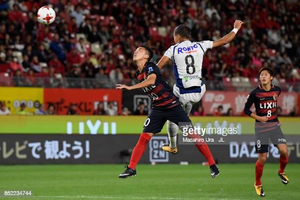 Hiroki Abe of Kashima Antlers and Yosuke Ideguchi of Gamba Osaka compete for the ball during the JLeague J1 match between Kashima Antlers and Gamba...