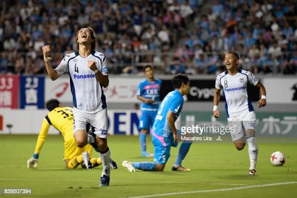 Hiroki Fujiharu of Gamba Osaka celebrates scoring his side's third goal during the JLeague J1 match between Sagan Tosu and Gamba Osaka at Best...