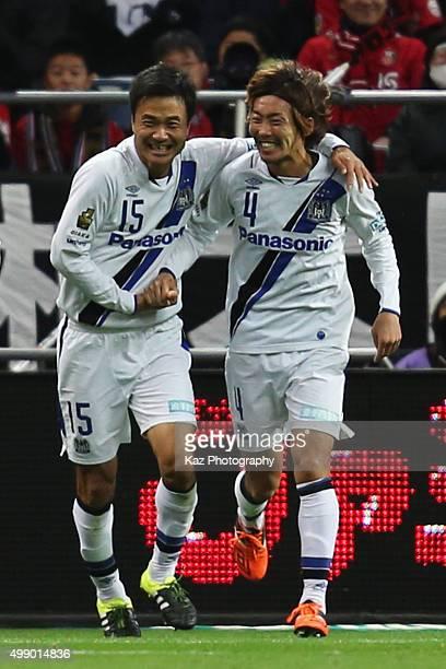 Hiroki Fujiharu of Gamba Osaka celebrates scoring his team's second goal with his team mate Yasuyuki Konno during the JLeague 2015 Championship semi...