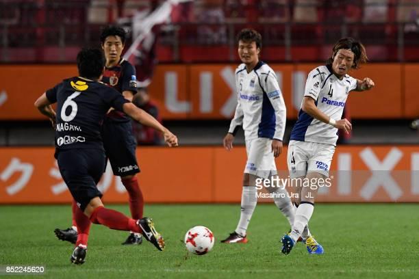 Hiroki Fujiharu of Gamba Osaka takes on Ryota Nagaki of Kashima Antlers during the JLeague J1 match between Kashima Antlers and Gamba Osaka at...