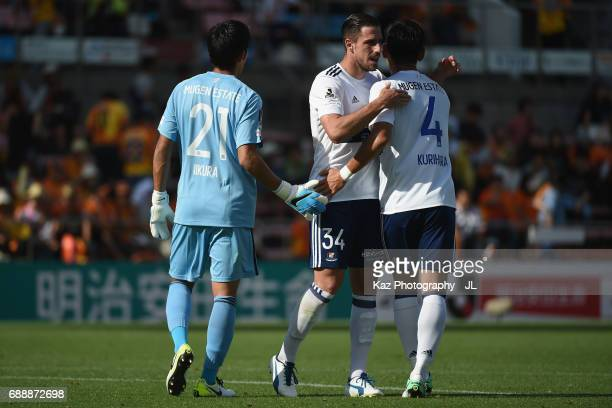 Hiroki Iikura Milos Degenek and Yuzo Kurihara of Yokohama FMarinos celebrate their 31 victory in the JLeague J1 match between Shimizu SPulse and...