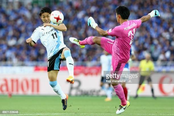 Hiroki Iikura of Yokohama FMarinos and Yu Kobayashi of Kawasaki Frontale compete for the ball during the JLeague J1 match between Yokohama FMarinos...