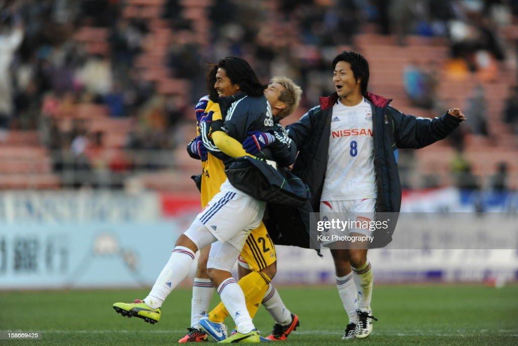 Hiroki Iikura of Yokohama F.Marinos celebrates with <a gi-track='captionPersonalityLinkClicked' href=/galleries/search?phrase=Yuji+Nakazawa&family=editorial&specificpeople=537311 ng-click='$event.stopPropagation()'>Yuji Nakazawa</a> and Kosuke Nakamichi after a penalty shoot out during the 92nd Emperor's Cup Quarter Final match between Nagoya Grampus and Yokohama F.Marinos at Mizuho Stadium on December 23, 2012 in Nagoya, Japan.
