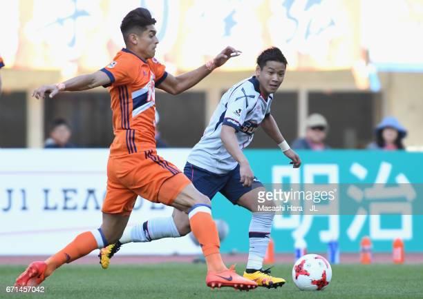 Hiroki Kawano of FC Tokyo and Romero Frank of Albirex Niigata compete for the ball during the JLeague J1 match between Albirex Niigata and FC Tokyo...