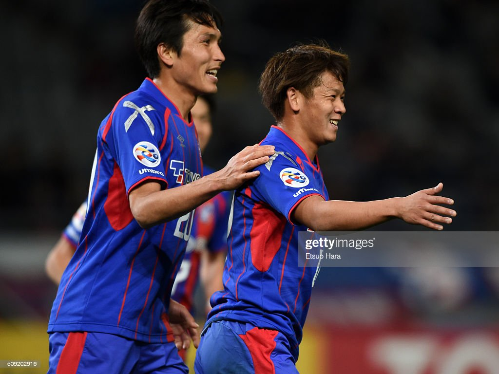 Hiroki Kawano of FC Tokyo(R) celebrates scoring his team's seventh goal during the AFC Champions League playoff round match between FC Tokyo and Chonburi FC at the Tokyo Stadium on February 9, 2016 in Chofu, Japan.