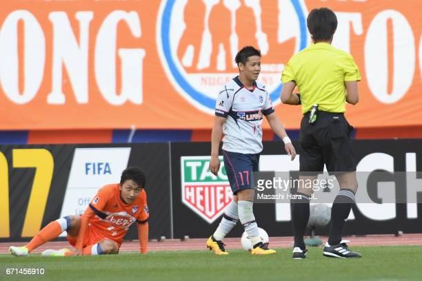 Hiroki Kawano of FC Tokyo reacts after receiving an yellow card during the JLeague J1 match between Albirex Niigata and FC Tokyo at Denka Big Swan...